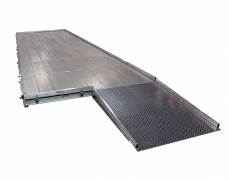 4'x4' Diamond Plate Ramp Attached to a Grated Aluminum Stage