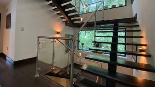 6W25 I-Beam and Mahogany Slab Stairs with Stainless Steel and Glass Handrails