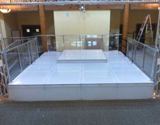 Custom Clear Plexi Guardrail System With Milk Surface Stage Decks and Closure Panels